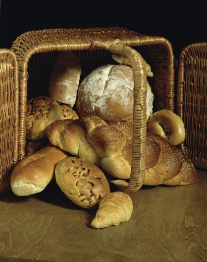 Assorted bread in a basket : Stock Photo