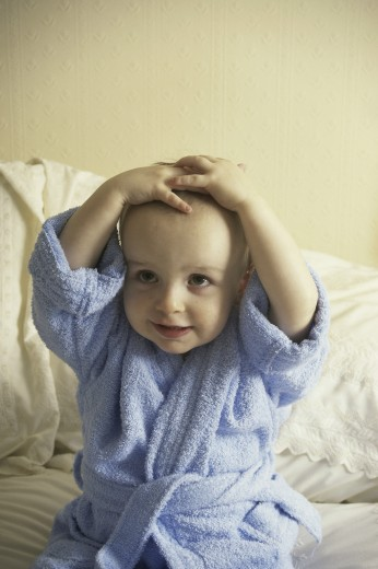 Stock Photo: 1574R-011312 Baby boy wearing a blue bathrobe