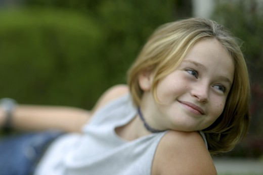 Stock Photo: 1574R-011363 Close-up of a girl lying down on a lawn