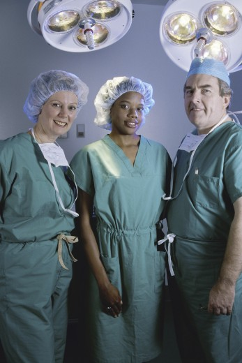 Stock Photo: 1574R-011639B Portrait of three surgeons in an operating room