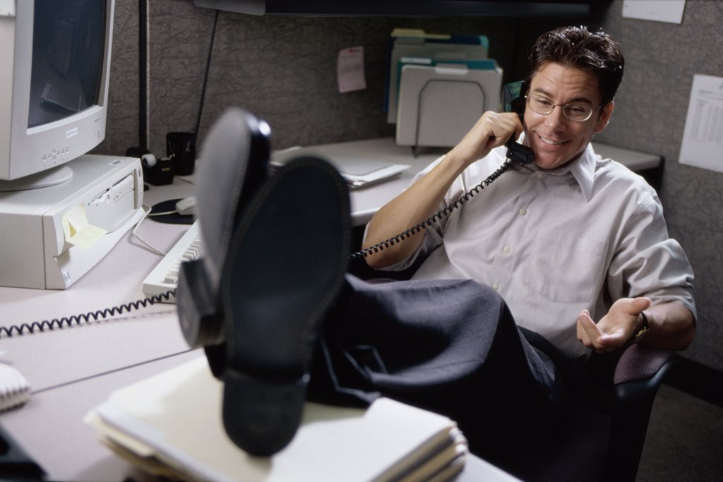 Businessman talking on a landline telephone on the desk : Stock Photo