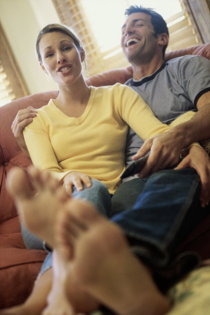 Mid adult couple watching television : Stock Photo