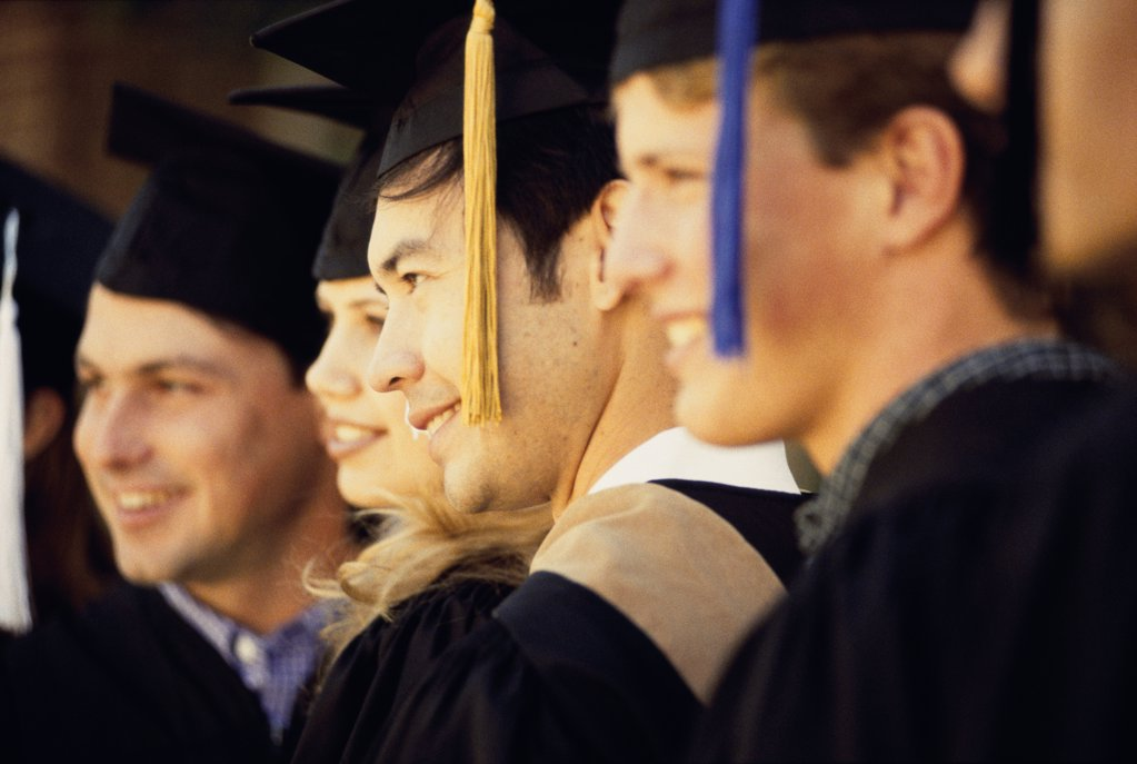 Stock Photo: 1574R-012404B Group of young graduates standing together
