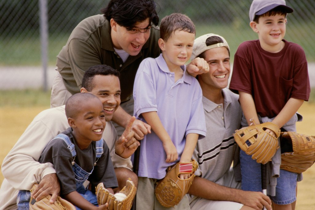 Stock Photo: 1574R-012463A Close-up of three fathers with their sons wearing baseball gloves in a baseball field