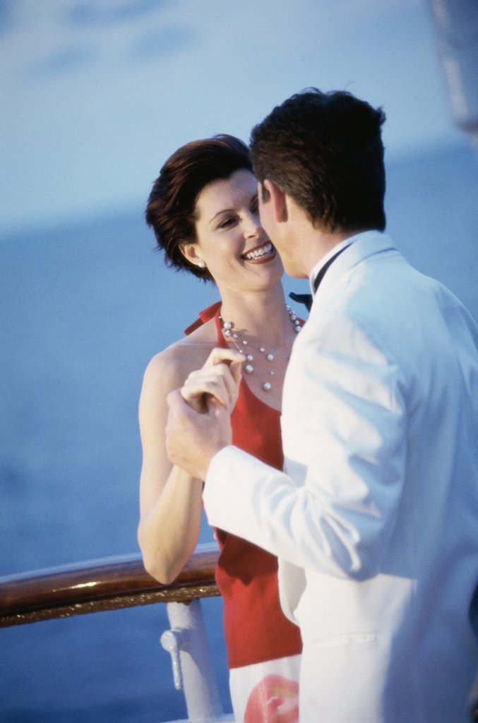 Young couple dancing on the deck of a cruise ship : Stock Photo