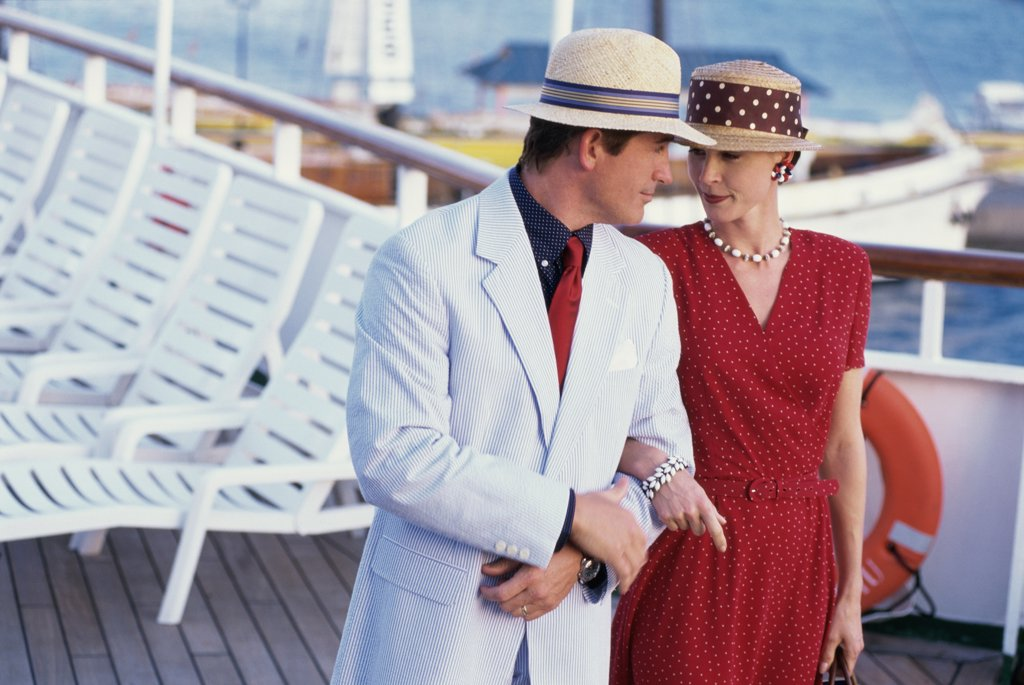 Close-up of a young couple looking at each other on a cruise ship : Stock Photo