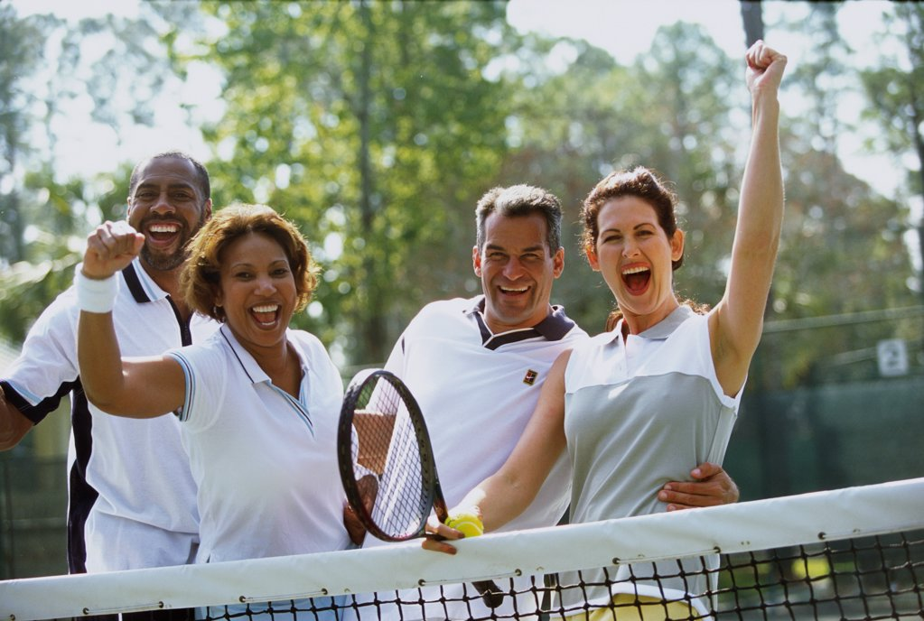 Stock Photo: 1574R-012785G Portrait of two mid adult couples cheering