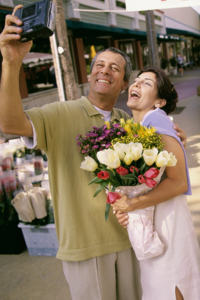 Stock Photo: 1574R-012808A Mature couple taking a photograph of themselves