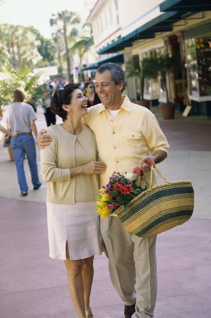 Stock Photo: 1574R-012817A Mature couple walking together