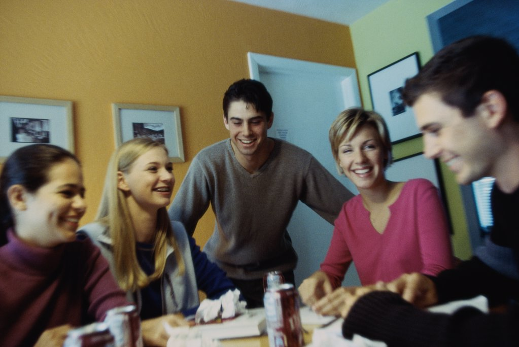 Three teenage girls and two teenage boys talking to each other : Stock Photo