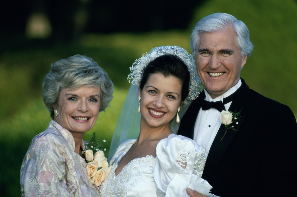 Stock Photo: 1574R-01307B Portrait of a bride standing with her parents