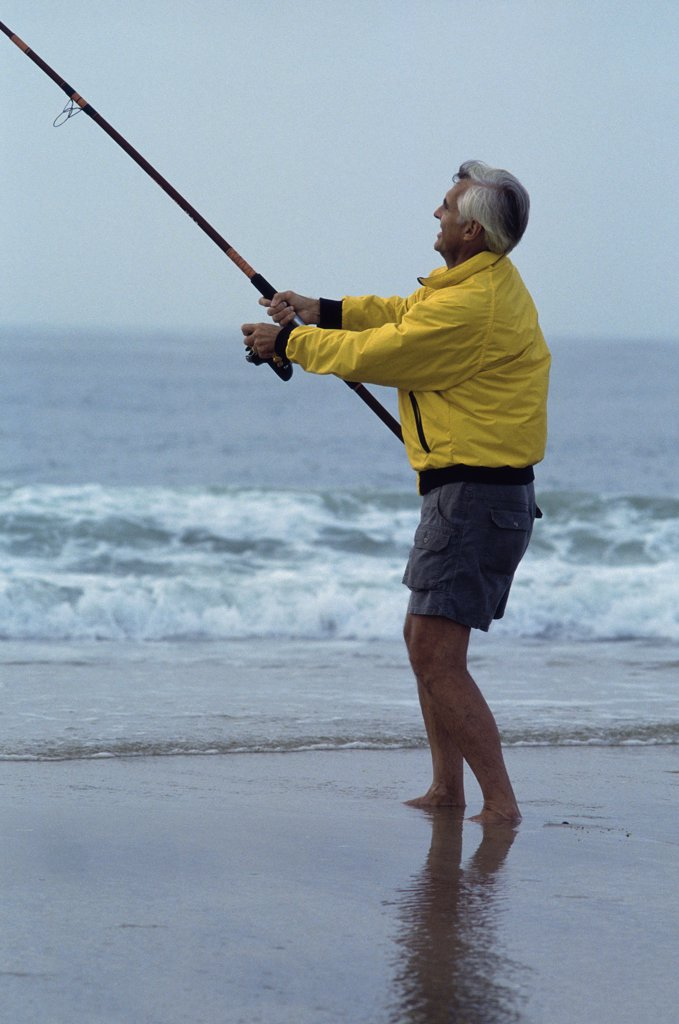 Stock Photo: 1574R-01308G Senior man fishing at the beach