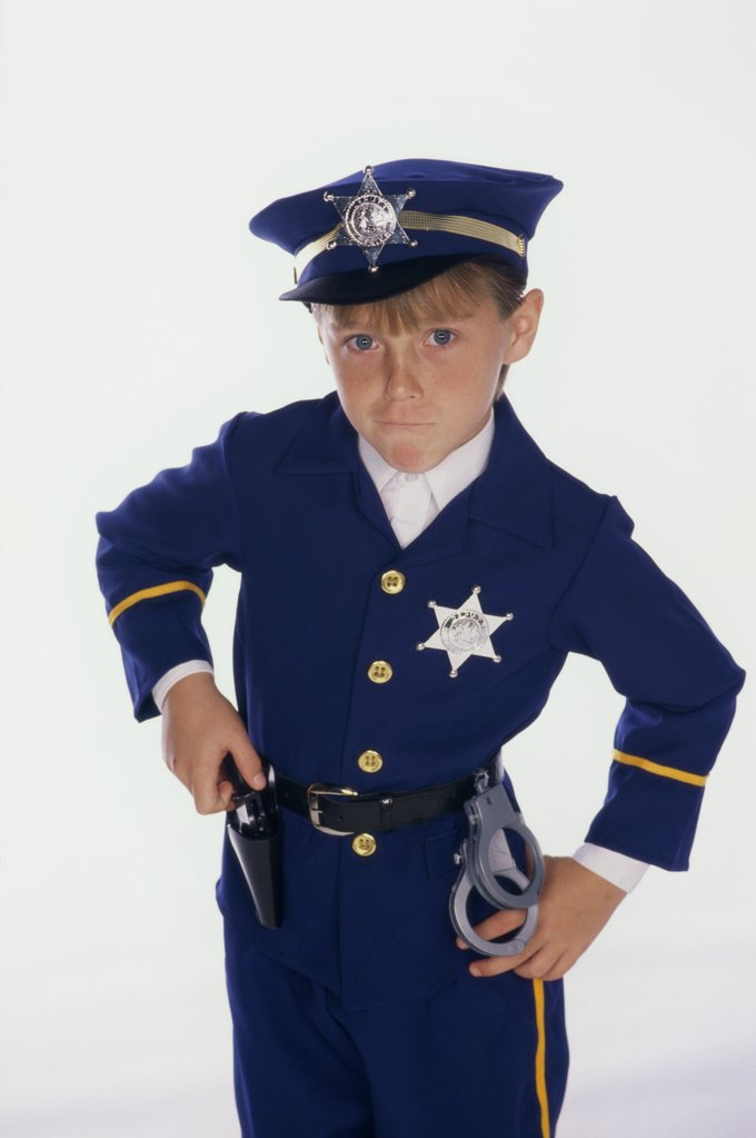 Stock Photo: 1574R-013179 Portrait of a boy dressed as a policeman