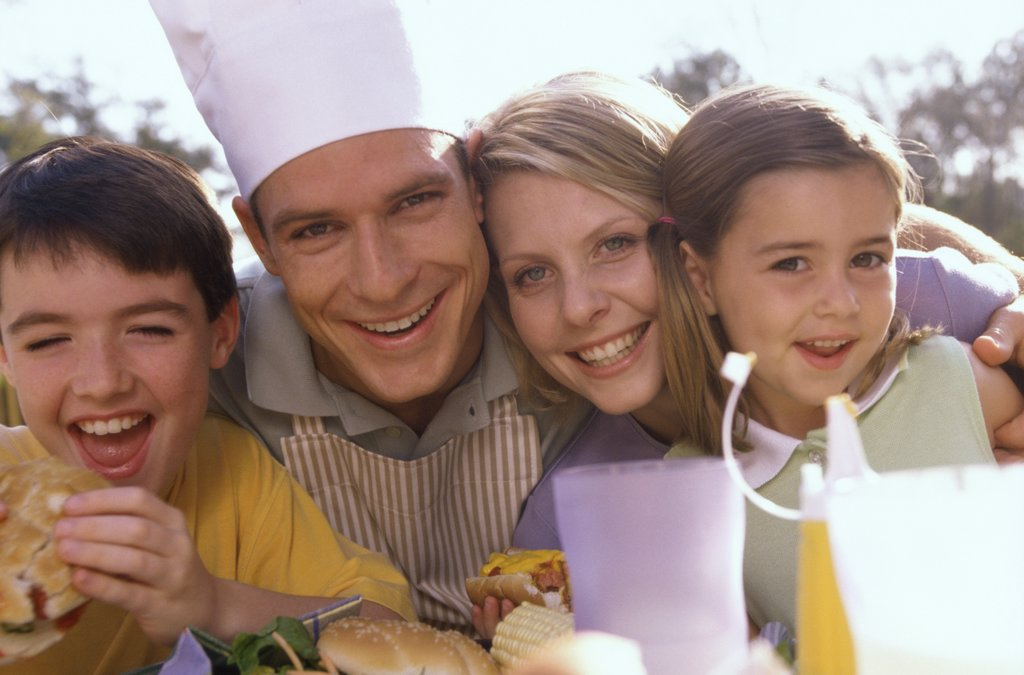 Portrait of parents with their son and daughter smiling : Stock Photo