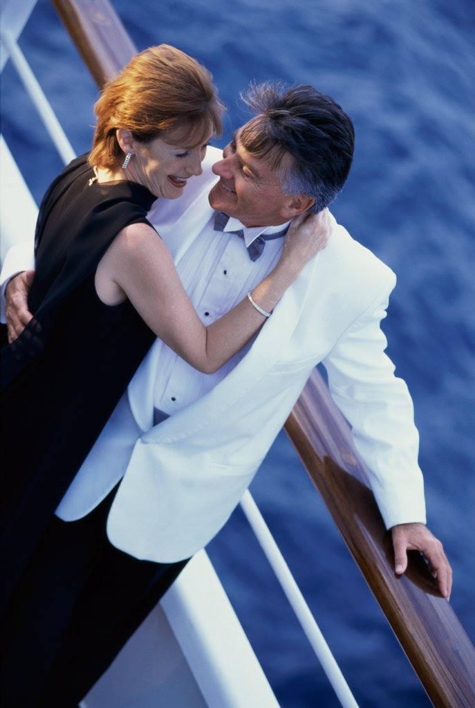 Stock Photo: 1574R-01345 Couple holding each other on a ship