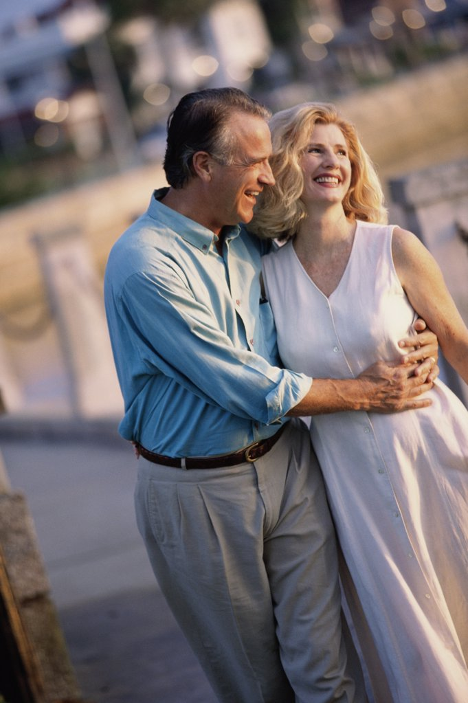 Mature couple walking together : Stock Photo