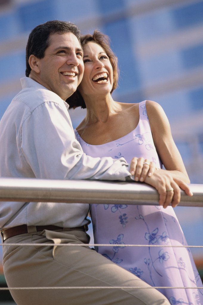 Low angle view of a mature couple standing together : Stock Photo