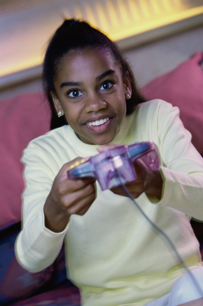 Stock Photo: 1574R-014455B Teenage girl playing video games