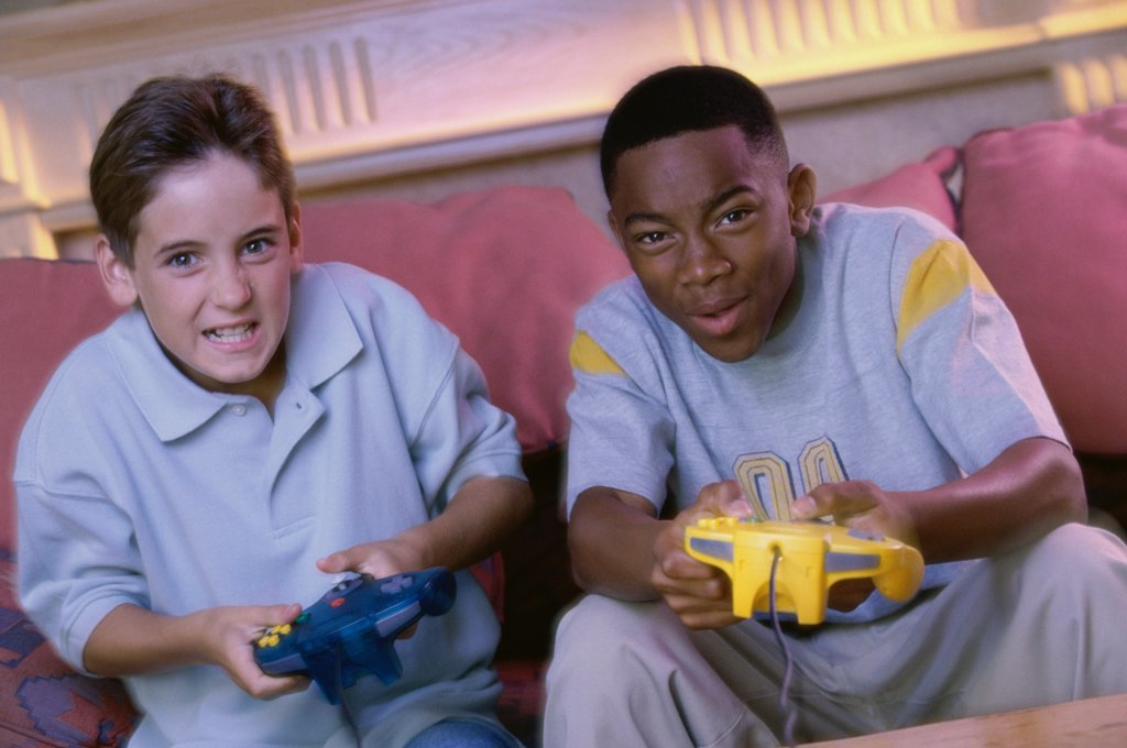 Stock Photo: 1574R-014476B Portrait of two teenage boys playing video games