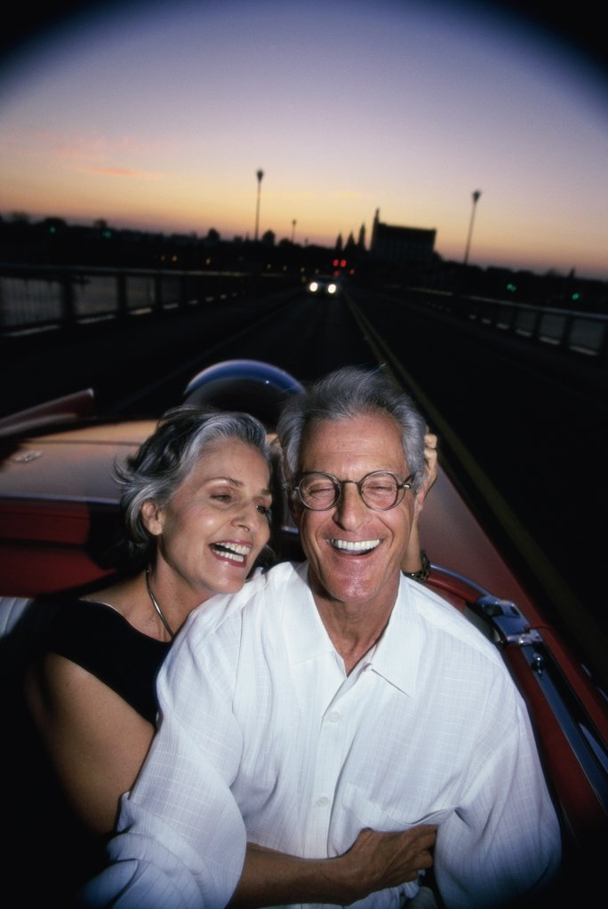 Senior couple sitting in a convertible car : Stock Photo