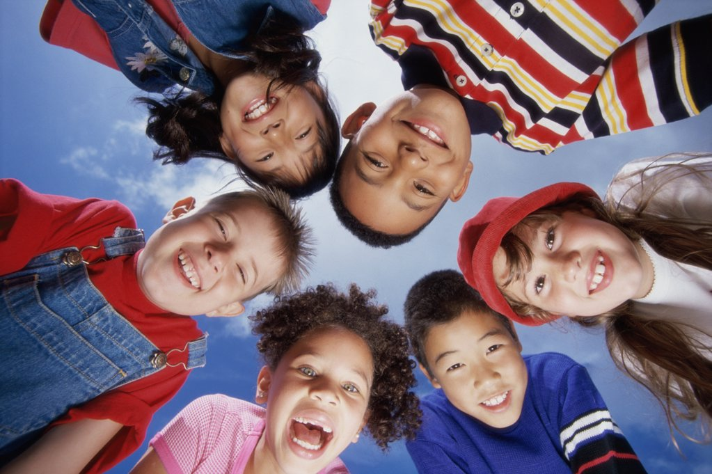 Portrait of a group of children in a huddle : Stock Photo