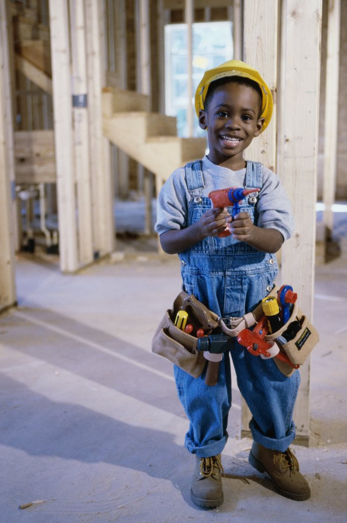 Stock Photo: 1574R-015124A Portrait of a boy dressed as a construction worker holding a toy drill