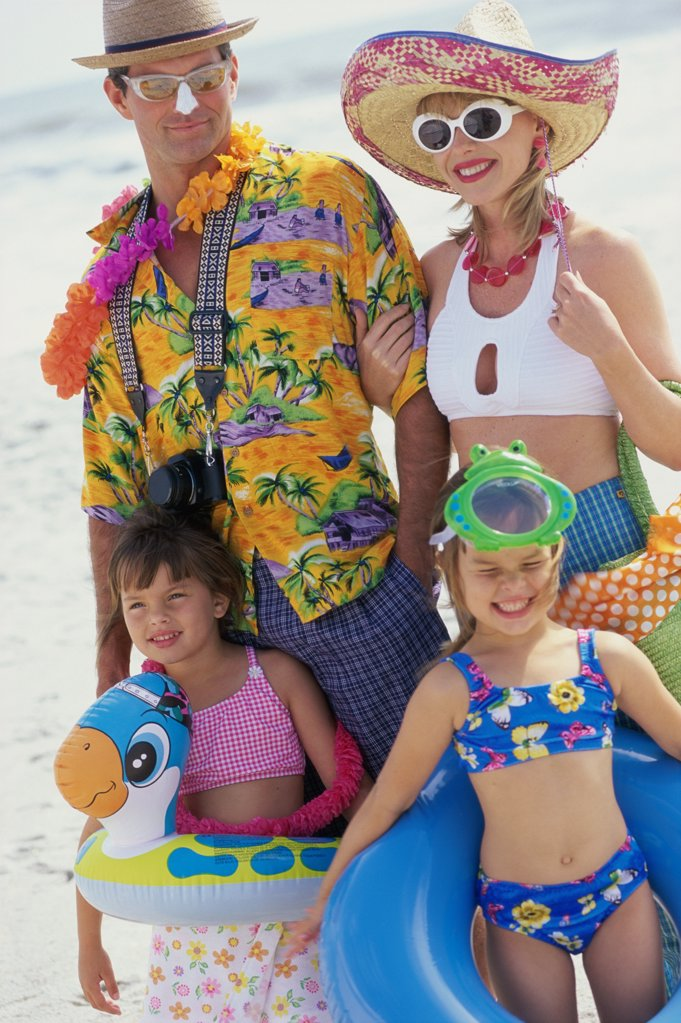 Father and mother with their children at the beach : Stock Photo