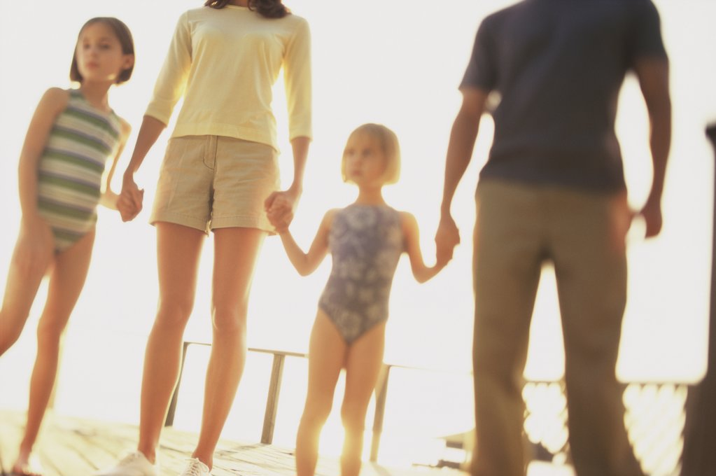 Low angle view of parents with their two daughters : Stock Photo