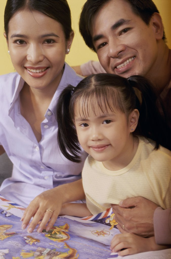 Portrait of parents and their daughter : Stock Photo