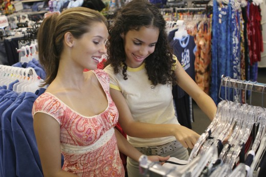 Stock Photo: 1574R-017651 High angle view of two young women selecting clothes in a clothing store