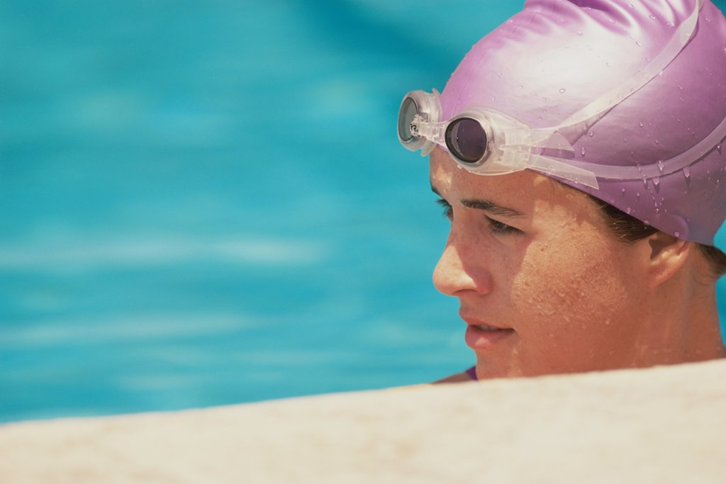 Young female swimmer in a swimming pool : Stock Photo