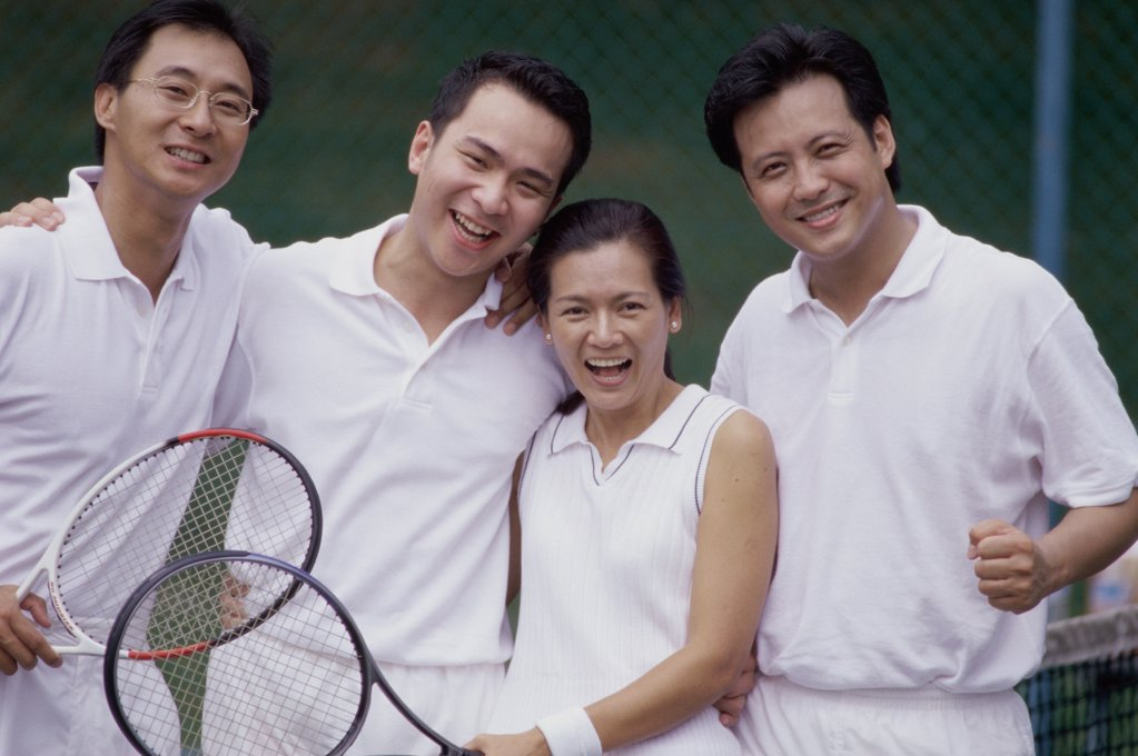 Portrait of a group of people at a tennis court : Stock Photo