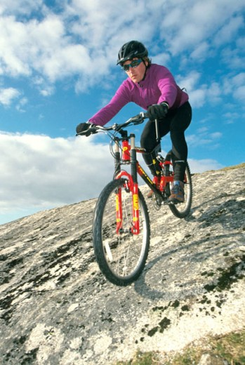 Stock Photo: 1574R-019539 Man mountain biking downhill