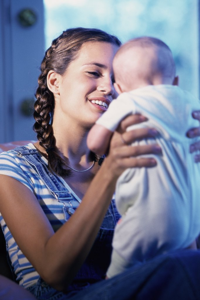 Stock Photo: 1574R-01971A Mother holding her baby boy