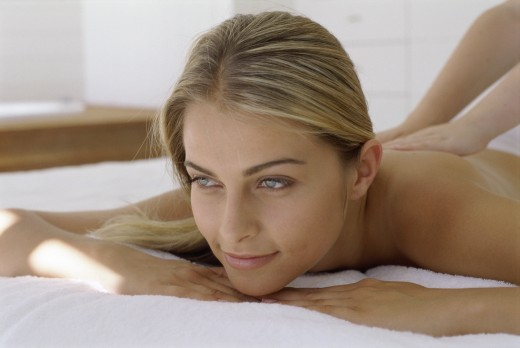 Close-up of a young woman getting a back massage : Stock Photo