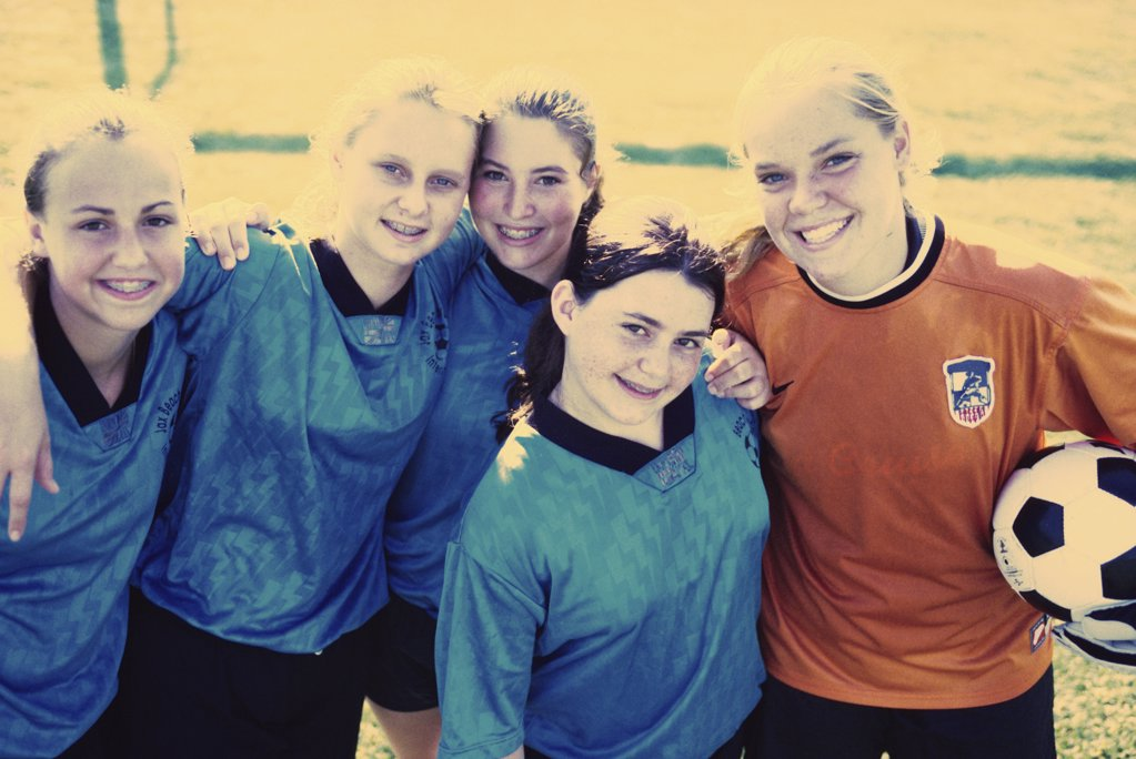 Portrait of a group of teenage girls in a soccer team : Stock Photo