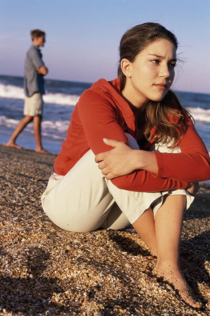Stock Photo: 1574R-02021A Teenage girl sitting at the beach