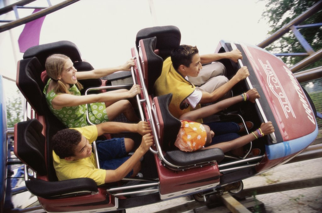 Stock Photo: 1574R-02031E Group of teenagers riding a rollercoaster