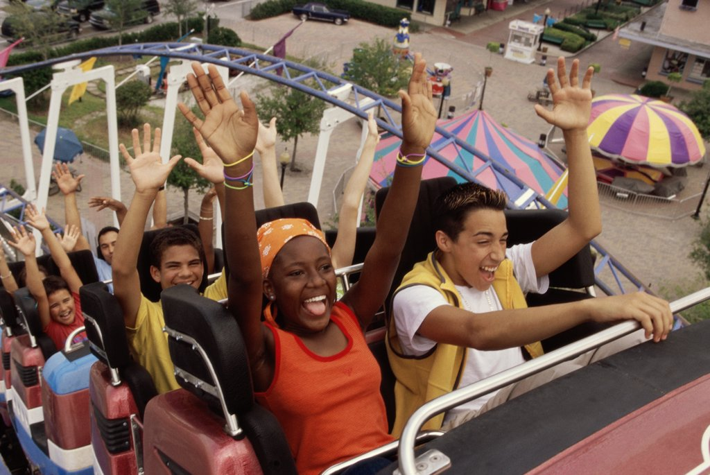 Stock Photo: 1574R-02032A Teenage boys and girls on a roller coaster ride