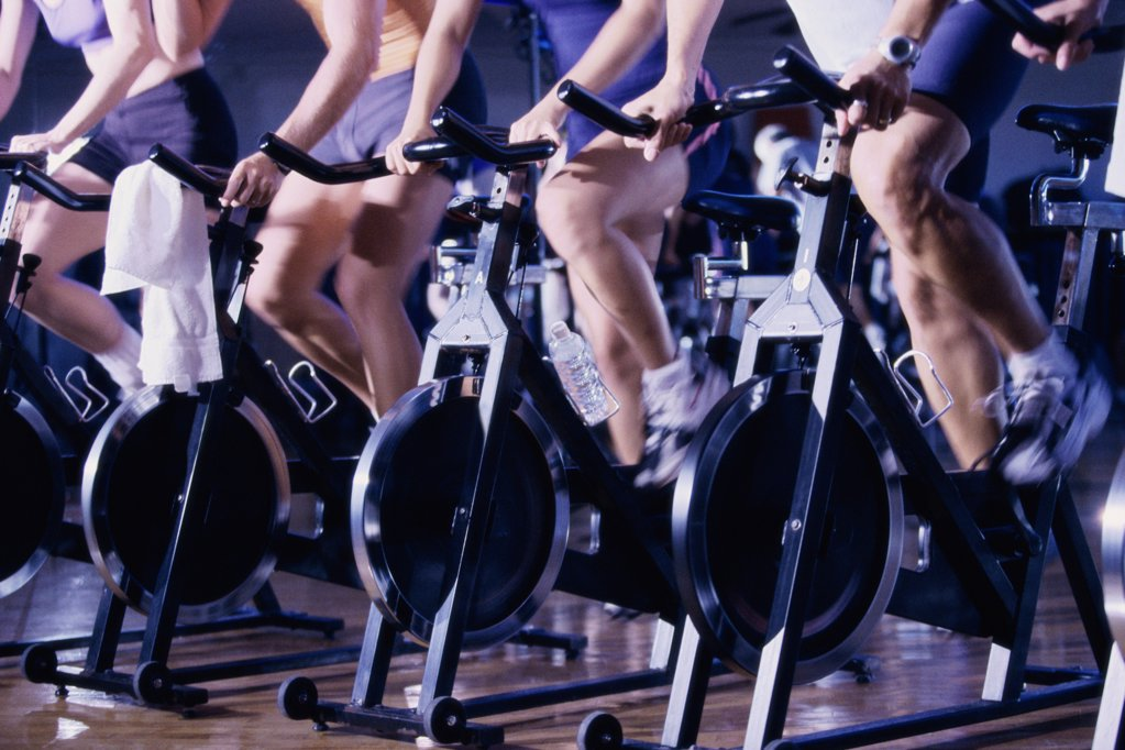Group of people exercising in a health club : Stock Photo