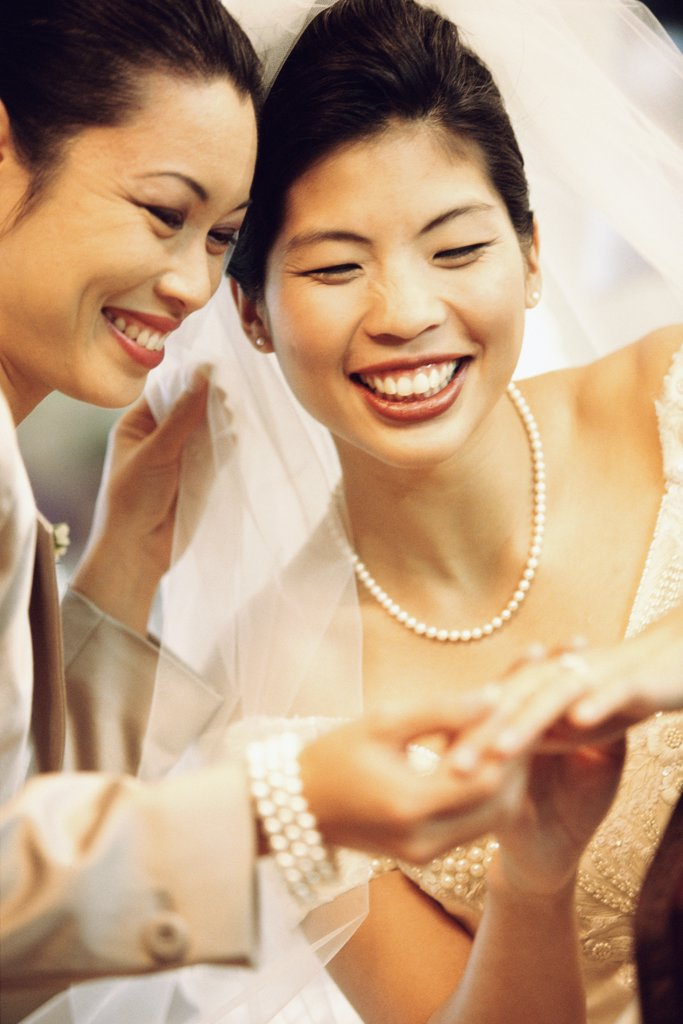 Stock Photo: 1574R-02139B Bride showing her wedding ring to her mother