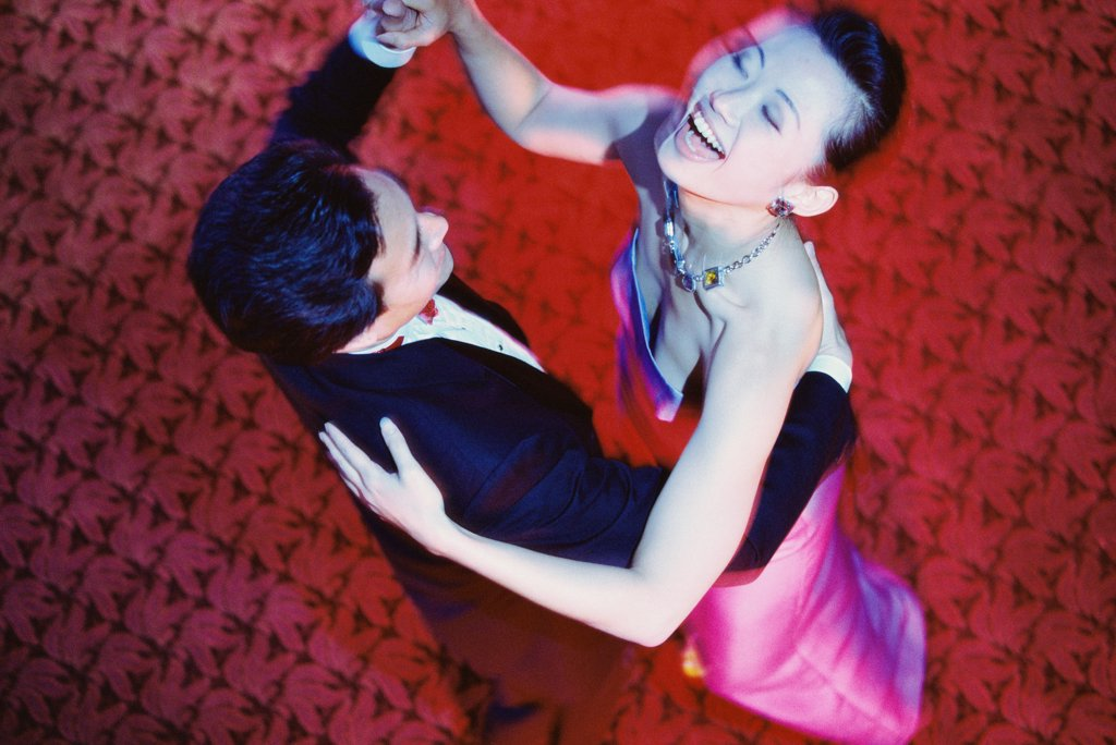 High angle view of a young couple dancing in a nightclub : Stock Photo