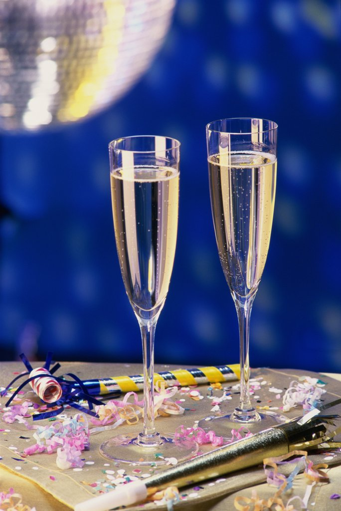 Close-up of two champagne flutes on a table : Stock Photo