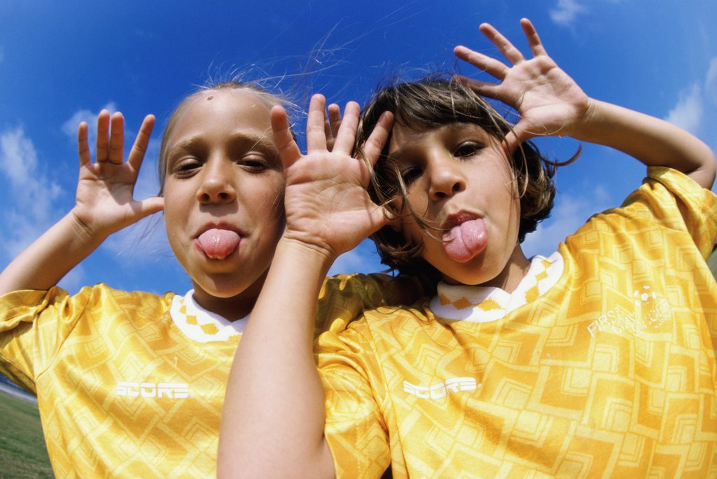 Stock Photo: 1574R-02442B Portrait of two girls making faces