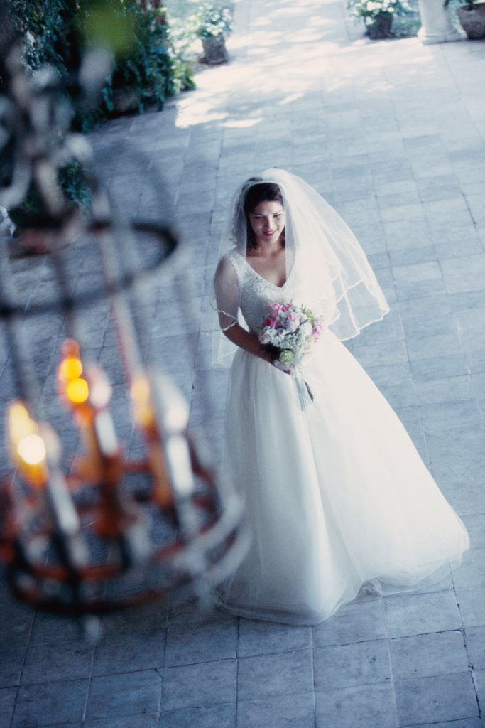 Stock Photo: 1574R-02527C High angle view of a bride holding a bouquet of flowers
