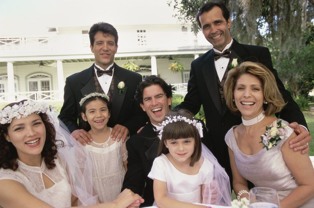Portrait of wedding guests with a newlywed couple : Stock Photo