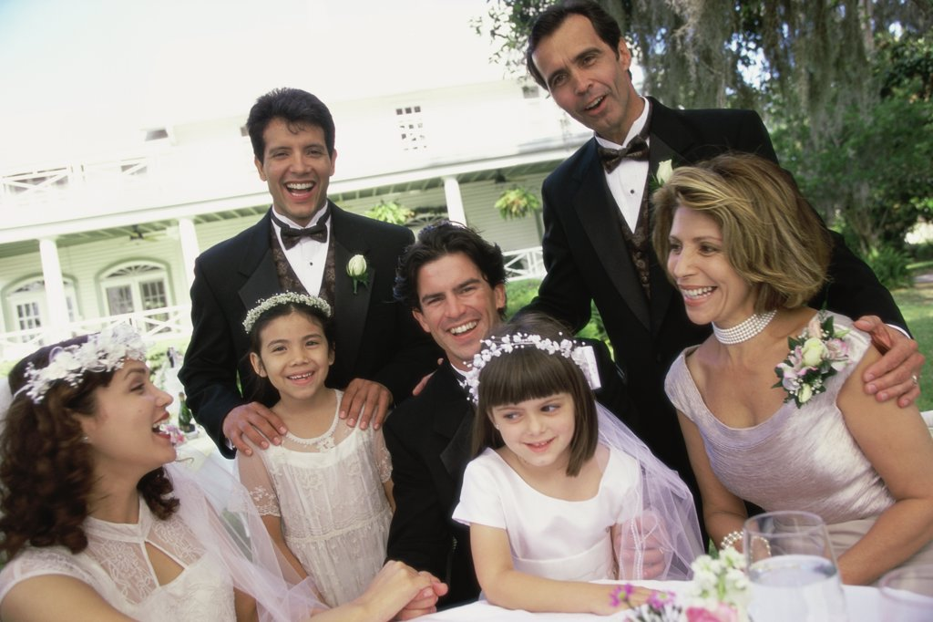 Stock Photo: 1574R-02534G Portrait of wedding guests with a newlywed couple