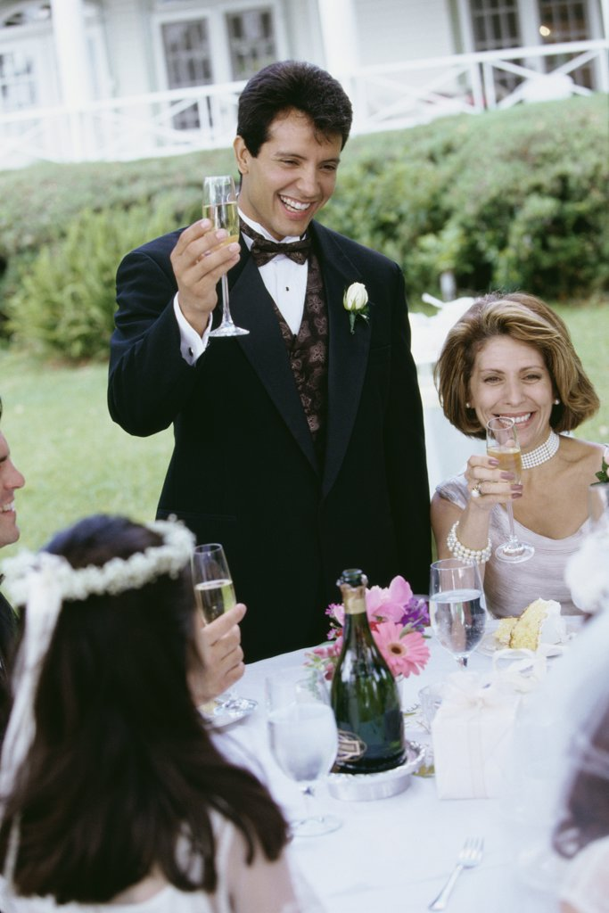 Group of people at a wedding toasting with glasses of champagne : Stock Photo