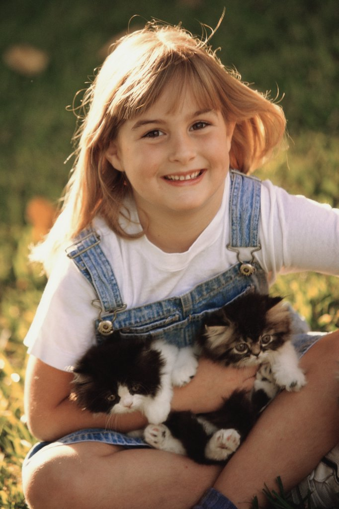 Portrait of a girl holding cats : Stock Photo