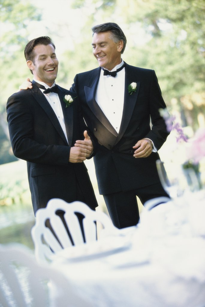 Newlywed young man talking with his father : Stock Photo